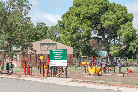 northern african: NOUPOORT, SOUTH AFRICA - MARCH 8, 2016: Unidentified children using innovative outdoor gym equipment in Noupoort in the Northern Cape Karoo Region.