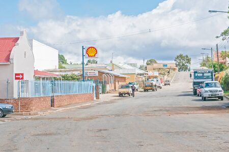 northern african: NOUPOORT, SOUTH AFRICA - MARCH 8, 2016: A street scene in Noupoort in the Northern Cape Karoo Region. Businesses, people and cars are visible Editorial