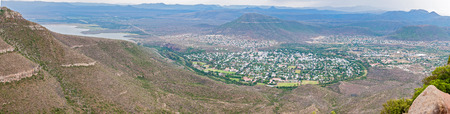 desolation: A panoramic view of Graaff Reinet as seen from the road to the Valley of Desolation viewpoint. The town lies in a horseshoe bend of the Sundays River