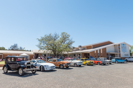 northern african: KIMBERLEY, SOUTH AFRICA - SEPTEMBER 24, 2016: A public display of new and vintage cars at a fair at the Dutch Reformed Church, Vooruitsig in Kimberley