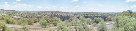 JAGERSFONTEIN, SOUTH AFRICA - DECEMBER 31, 2016: Panorama of the Jagersfontein diamond mine, which claims the title of the biggest hand dug hole in the world
