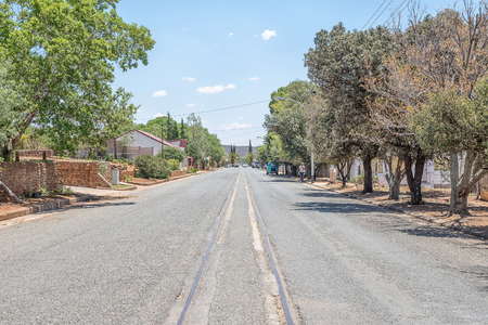 FAURESMITH, SOUTH AFRICA - DECEMBER 31, 2016: A street scene in Fauresmith, one of only three towns on earth where the railway line runs down the centre of the main road Editorial