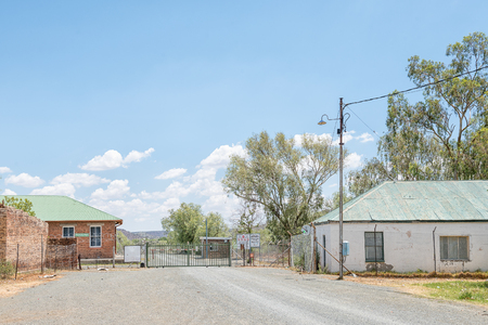 JAGERSFONTEIN, SOUTH AFRICA - DECEMBER 31, 2016: Entrance to the Jagersfontein diamond mine. The town claims the title of oldest mining town in South Africa and biggest hand dug hole in the world