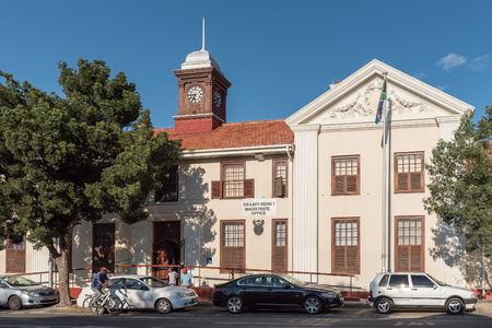 magistrates: GRAAFF REINET, SOUTH AFRICA - MARCH 23, 2017: A street scene in Graaff Reinet with the magistrate office in the back