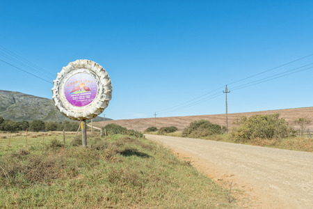 ortseingangsschild: RIVIERSONDEREND, SOUTH AFRICA - MARCH 26, 2017: Sign at the entrance to the Khomeesdrif Camping Site near Riviersonderend, a town in the Western Cape Province