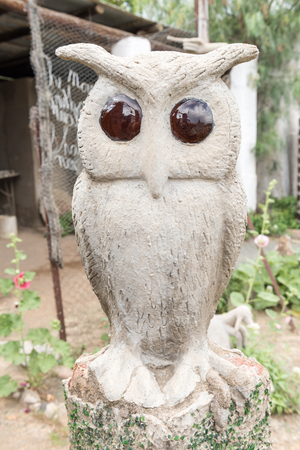 bethesda: A concrete and glass owl sculpture at the Owl House in Nieu-Bethesda, an historic village in the Eastern Cape Province
