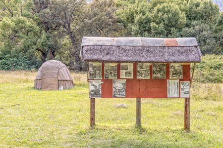 GENADENDAL, SOUTH AFRICA - MARCH 27, 2017: A Khoi hut and information board at the Khoi kraal at the mission in Genadendal. Genadendal is the first mission station in South Africa, founded 1738