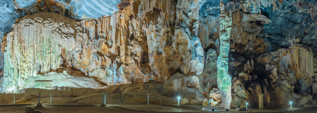 Panorama of the Organ, Cleopatras Needle and other stalagmites and stalactites in the Van Zyl Hall of the Cango Caves. Algae grow on it due to the artificial lighting