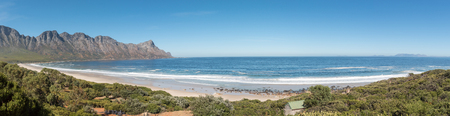 Panoramic view of the coastline on Clarence Drive between Gordons Bay and Rooi-Els. Cape Point is visible across the bay