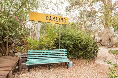 DARLING, SOUTH AFRICA - MARCH 31, 2017: A bench and name sign at Evita se Perron in Darling, a town in the Western Cape Province Editorial
