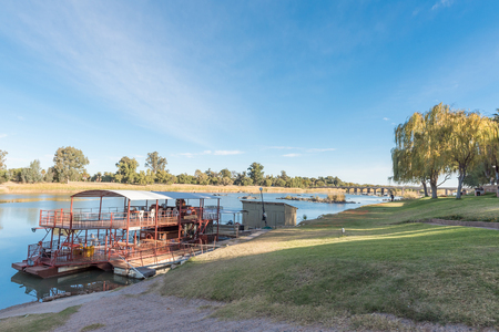 UPINGTON, SOUTH AFRICA - JUNE 11, 2017: Sakkie se Arkie, a river boat at a holiday resort with the same name, next to the Orange River at Upington, a town in the Northern Cape Province