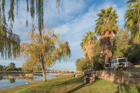 UPINGTON, SOUTH AFRICA - JUNE 12, 2017: Camping sites at Sakkie se Arkie, a holiday resort next to the Orange River at Upington, a town in the Northern Cape Province