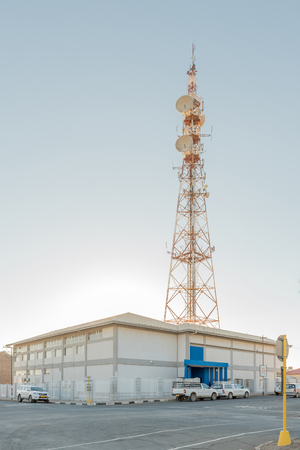 KEETMANSHOOP, NAMIBIA - JUNE 13, 2017: Technical offices of Telecom Namibia with a microwave telecommunications tower on top in Keetmanshoop, the capital town of the Karas Region of Namibia Editorial
