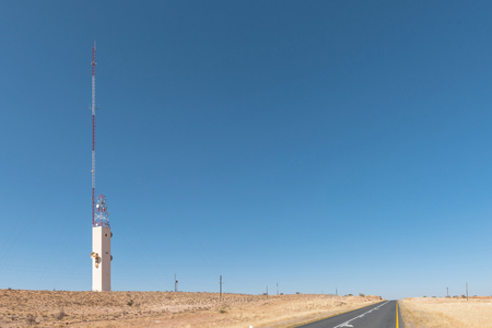 A microwave telcommunications tower and a cell phone tower near Kalkrand, a village on the B1-road between Mariental and Rehoboth Stock Photo