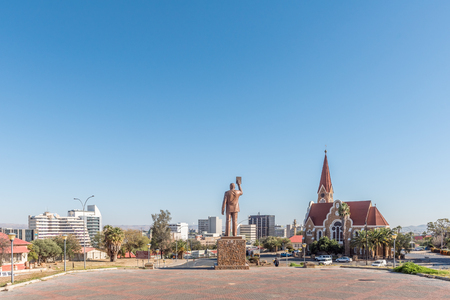 WINDHOEK, NAMIBIA - JUNE 17, 2017: A view of Windhoek as seen from the Independence Memorial. The statue of Dr. Sam Nujoma and the Christuskirche are visible