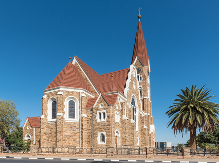 noon: WINDHOEK, NAMIBIA - JUNE 17, 2017: The back side of the Christuskirche, an historic German Lutheran church in Windhoek Editorial