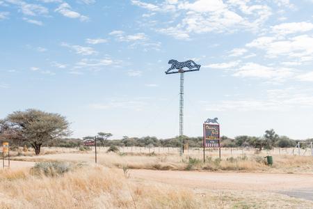 OKAHANDJA, NAMIBIA - JUNE 19, 2017:  Sign boards for the Okonjima Africat reserve between Okahandja and Otjiwarongo in the Otjozondjupa Region of Namibia Editorial