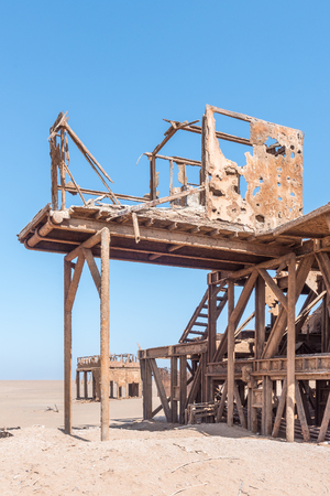 The rusted remains of an abandoned oil drilling rig between Henties Bay and Torra Bay in the Skeleton Coast area of Namibia
