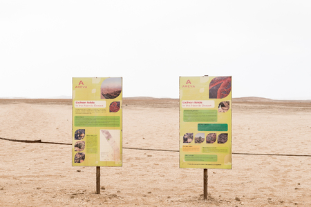 HENTIES BAY, NAMIBIA - JUNE 29, 2017: Information boards at the viewpoint for lichen fields in the Namib Desert between Henties Bay and Swakopmund on the Skeleton Coast of Namibia