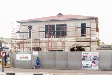 restored: SWAKOPMUND, NAMIBIA - JUNE 30, 2017: An historic building being restored in Swakopmund, in the Namib Desert on the Atlantic Coast of Namibia
