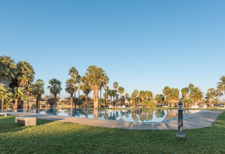 Sunset view of a swimming pool at Gross Barmen, near Okahandja in the Otjozondjupa Region of Namibia Stock Photo