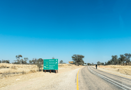 ASKHAM, SOUTH AFRICA - JULY 6, 2017: A directional sign, on the R360-road from Tweerivieren in the Kgalagadi, at the junction with the R31-road in the Northern Cape Province of South Africa