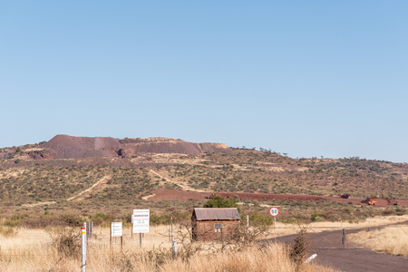 POSTMASBURG, SOUTH AFRICA - JULY 7, 2017: Entrance to the Morokwa manganese mine on the R386-road between Olifantshoek and Postmasburg in the Northern Cape Province of South Africa Editorial