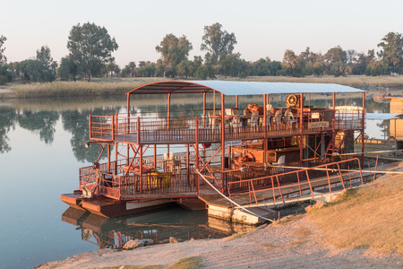 UPINGTON, SOUTH AFRICA - JULY 7, 2017: Sunrise at Sakkie se Arkie, a river boat at a holiday resort with the same name, next to the Orange River at Upington Editorial