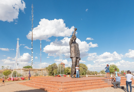 BLOEMFONTEIN, SOUTH AFRICA, DECEMBER 11, 2016: Unidentified visitors at the 6.5m bronze statue of Nelson Mandela on Naval hill in Bloemfontein Editorial
