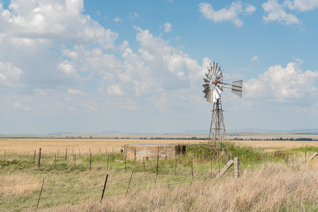 A farm scene with water-pumping windmill and dam next to the R703-road between Verkeerdevlei and Excelsior in the Free State Province of South Africa