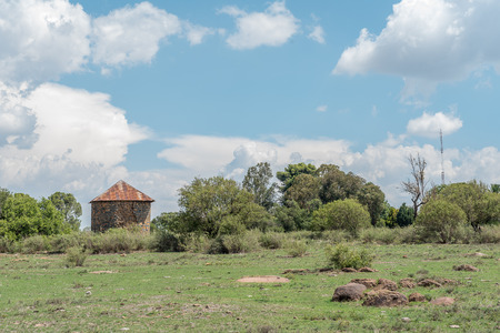A farm scene with an old storage building near Verkeerdevlei in the Free State Privince of South Africa Stock Photo