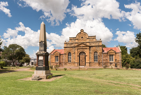 FICKSBURG, SOUTH AFRICA - MARCH 12, 2018: The sandstone town hall, completed in 1887, and the monument for General J.I.J. Fick, after whom in Ficksburg was named Sajtókép