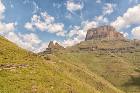 The Sentinel Trail to the Tugela Falls in the Drakensberg climbs past the Three Witches and then zig-zags up the slopes of the Sentinel Stock Photo