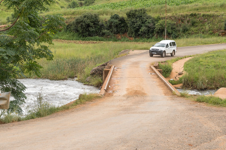 WINTERTON, SOUTH AFRICA - MARCH 18, 2018: A vehicle is about to cross the single lane bridge over the Mlambona River near Emmaus in the Kwazulu-Natal Province Editorial