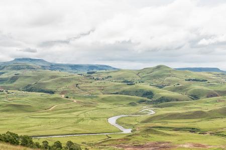 A farm landscape with the Mlambonja River near Cathedral Peak in the Kwazulu-Natal Drakensberg
