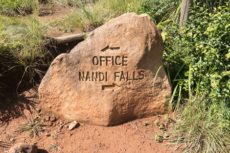 MONKS COWL, SOUTH AFRICA - MARCH 18, 2018: An engraved rock used as directional sign on a hiking trail at Monks Cowl in the Drakensberg. Editorial