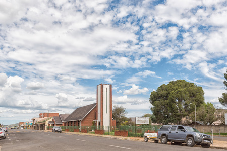 DUNDEE, SOUTH AFRICA - MARCH 21, 2018: A street scene with the Methodist Church in Dundee in the Kwazulu-Natal Province. Vehicles and businesses are visible