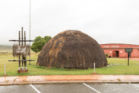 BLOEDRIVIER, SOUTH AFRICA - MARCH 22, 2018: Visitors parking and Zulu hut at the Ncome Zulu Heritage Museum at Bloedrivier (blood river) where the Voortrekkers defeated the Zulu Impis 16-12-1838