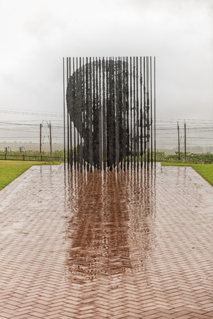 HOWICK, SOUTH AFRICA - MARCH 23, 2018: The statue of Nelson Mandela at his capture site near Howick. At a specific viewpoint, the steel colums combine to form his face Editorial