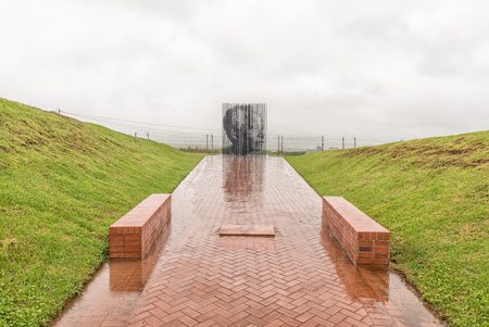 HOWICK, SOUTH AFRICA - MARCH 23, 2018: The statue of Nelson Mandela at his capture site near Howick. At a specific viewpoint, the steel colums combine to form his face Sajtókép