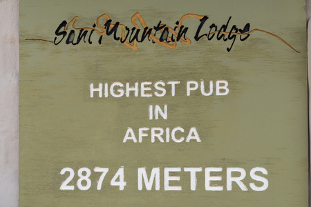 SANI TOP, LESOTHO - MARCH 24, 2018: A plaque at the Sani Mountain Lodge at the top of the Sani Pass. The lodge claims the title of highest pub in Africa Editorial