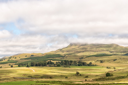 A farm landscape on the R617-road between Underberg and Kokstad in the Kwazulu-Natal Province