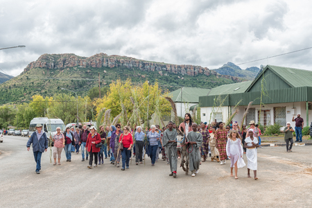 LADY GREY, SOUTH AFRICA - MARCH 31, 2018: A street scene of the yearly passion play in Lady Grey in the Eastern Cape Province. People and a donkey are visible