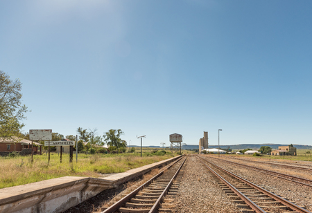 MARSEILLES, SOUTH AFRICA - MARCH 12, 2018: The railway station in Marseilles, a village in the Free State Province. Grain silos are visible
