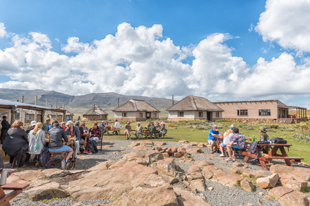 SANI TOP, LESOTHO - MARCH 24, 2018: Unidentified tourists at the Sani Mountain Lodge at the top of the Sani Pass. The lodge claims the the title of highest pub in Africa Editorial