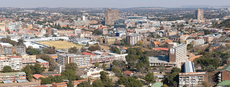 BLOEMFONTEIN, SOUTH AFRICA, JUNE 27, 2018: Panorama of part of Bloemfontein CBD, as seen from Naval Hill. The historic Ramblers sports grounds and the Free State Stadium are visible