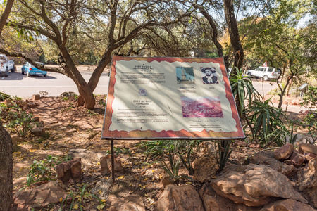 PRETORIA, SOUTH AFRICA, JULY 31, 2018: An information board for the Piet Retief Monument, in the forest at the Voortrekker Monument on Monument Hill in Pretoria Editorial