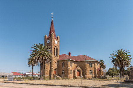 VREDEFORT, SOUTH AFRICA, AUGUST 2, 2018: A street scene, with the Dutch Reformed Church, in Vredefort in the Free State Province Province. Palm trees are visible Editorial