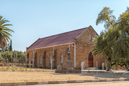 VREDEFORT, SOUTH AFRICA, AUGUST 2, 2018: The hall of the Dutch Reformed Church, in Vredefort in the Free State Province Province. Palm trees are visible