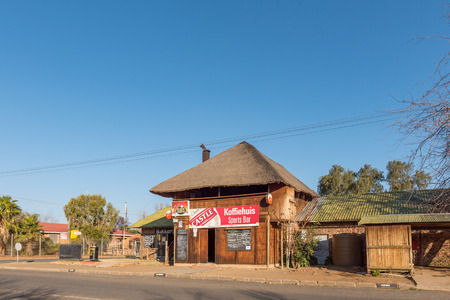 BRANDFORT, SOUTH AFRICA, AUGUST 2, 2018: A street scene, with coffee shop, bar and bakery, in Brandfort in the Free State Province Province at sunset